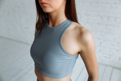 cropped closeup of the body of a fit woman wearing a sports bra-img-blog