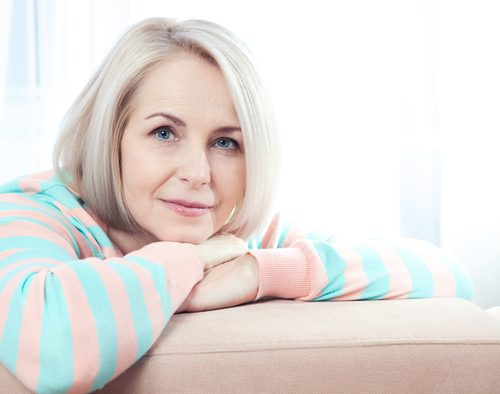 active beautiful middle-aged woman smiling friendly and looking into the camera at home-img-blog