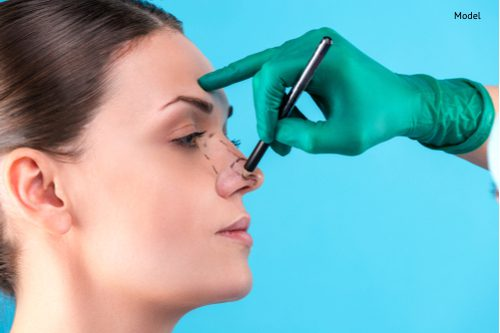 cosmetic surgeon examining female client in office-img-blog
