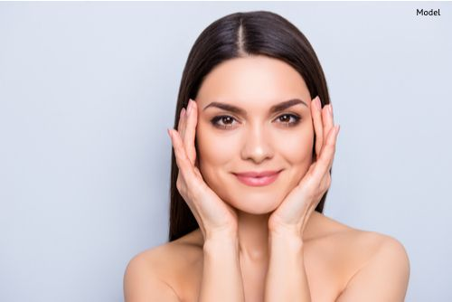 Gorgeous aesthetic woman with natural makeup enjoying her flawless perfect skin after laser procedure