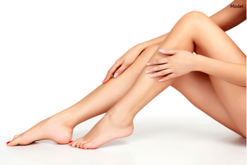 Women enjoying her vein-free legs after sclerotherapy treatment.