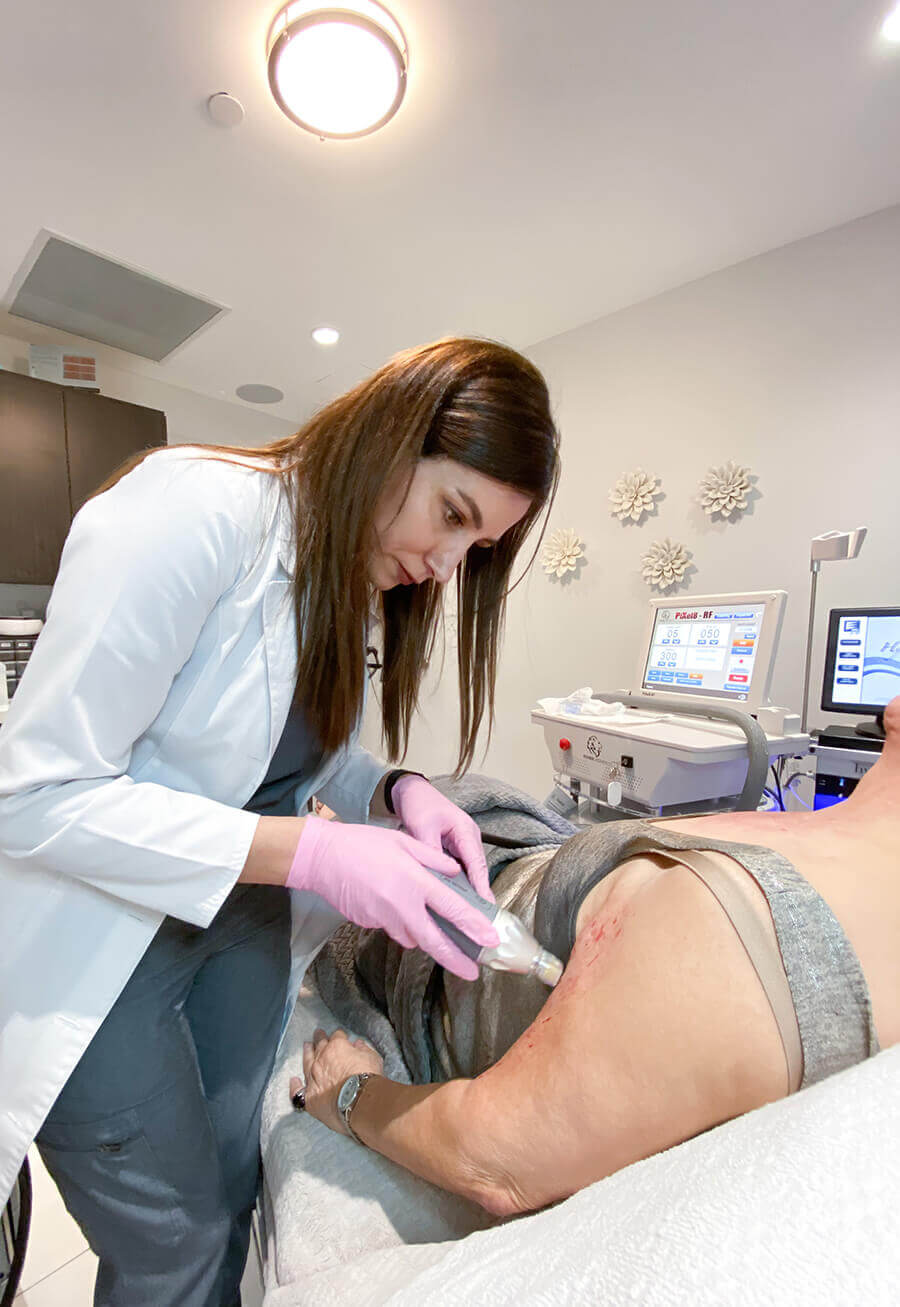Staff applying PiXel8-RF treatment on a patient