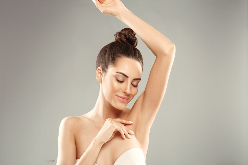 Close-up image of a woman caressing her armpit